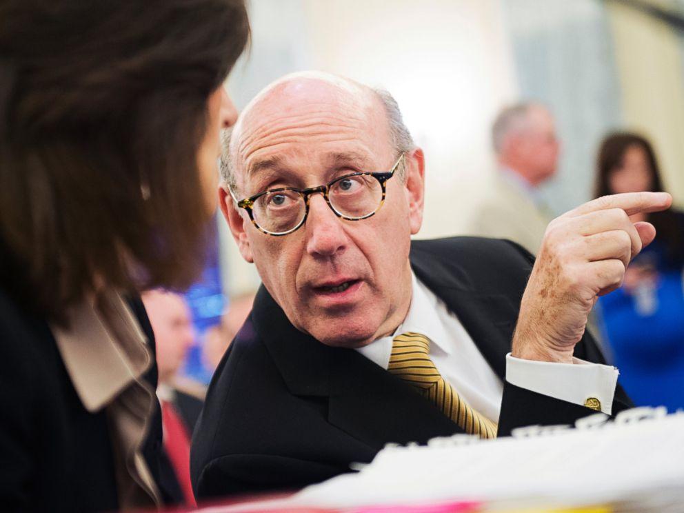 PHOTO: Ken Feinberg talks with colleague Camille Biros in Washington, July 17, 2014.