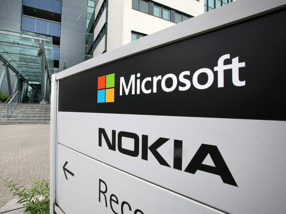 PHOTO: Microsoft and Nokia signs are seen in Peltola Oulu, Finland, July 16, 2014.