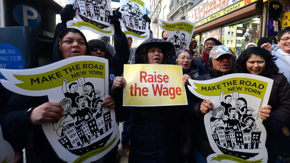 Fast-food workers calling for better wages demonstrate outside a McDonald's restaurant on Fifth Avenue in New York, March 18, 2014.