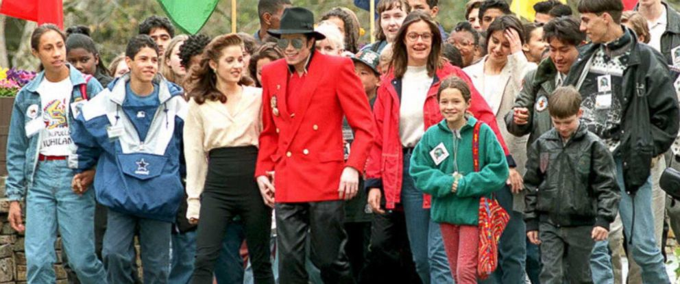 PHOTO: Michael Jackson and Lisa Marie Presley walk with children at Neverland Ranch in Los Olivos, Calif. on April 18, 1995.
