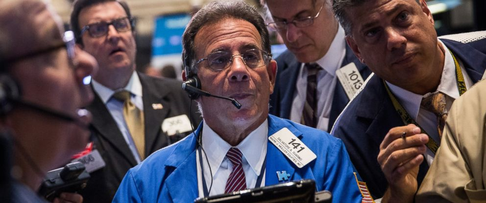 PHOTO: Traders work on the floor of the New York Stock Exchange during the morning of Aug. 27, 2015 in New York City.