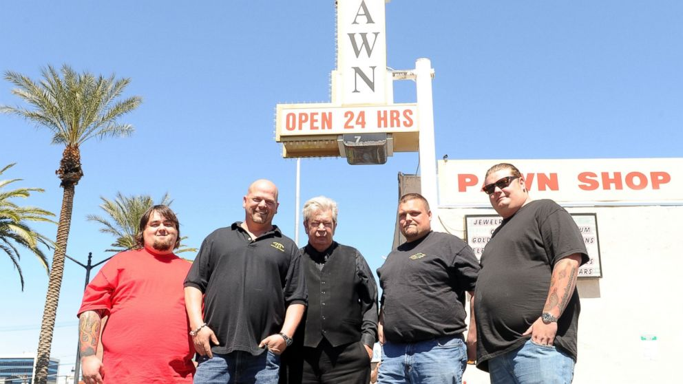 """From left, """"Pawn Stars"""" Austin """"Chumlee"""" Russell, Rick Harrison, Richard Harrison and Corey Harrison pose for photos with """"Ax Man"""" Gabe Rygaard at Gold and Silver Pawn in Las Vegas, Nevada, April 7, 2010."""