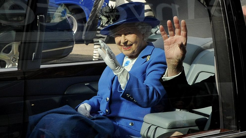 Queen Elizabeth II waves from her car as she leaves Investec Derby Day at Epsom Downs Racecourse in Epsom, England, June 2, 2012.