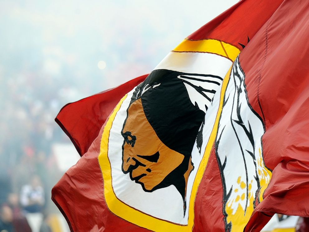PHOTO: A Redskins flag is displayed at a game between the Dallas Cowboys and the Washington Redskins