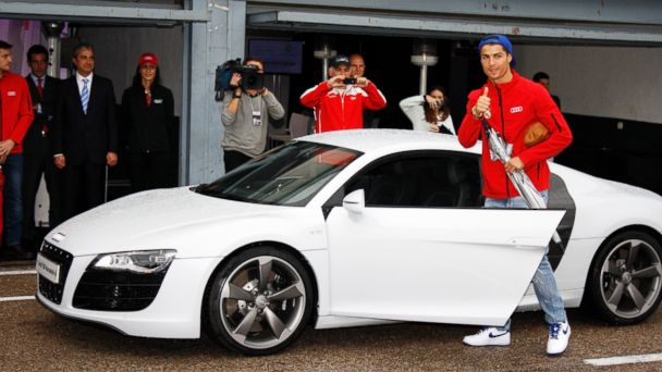 PHOTO: Real Madrid player Cristiano Ronaldo receives the keys of the new Audi car during the presentation of Real Madrids new cars made by Audi at the Jarama racetrack in this Nov. 8, 2012, file photo in Madrid, Spain.