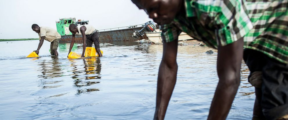 PHOTO: Young men load water from the Nile river into containers, Feb. 26, 2014 in Bor, South Sudan.