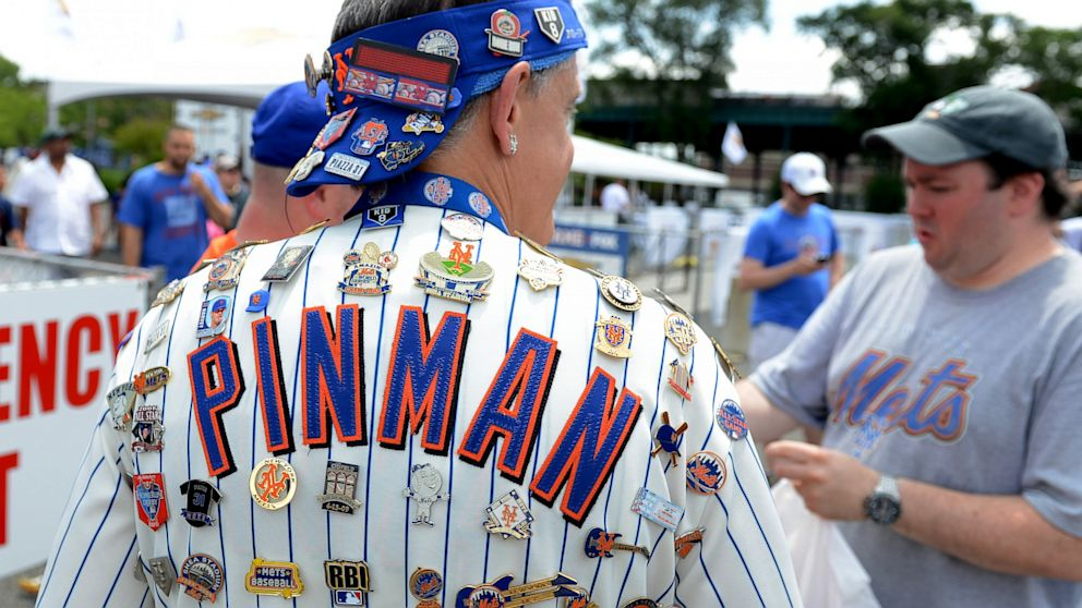 A fan adorned with pins outside Citi Field prior to the 2013 SiriusXM All-Star Futures Game at Citi Field, July 14, 2013, in New York City.