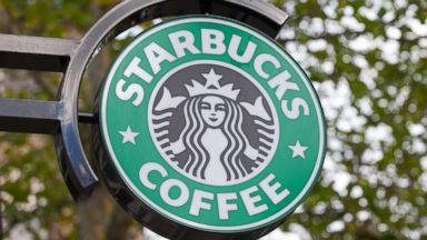 PHOTO: A Starbucks Corp. logo hangs outside one of the companys coffee shops in Hamburg, Germany, Nov. 9, 2013.