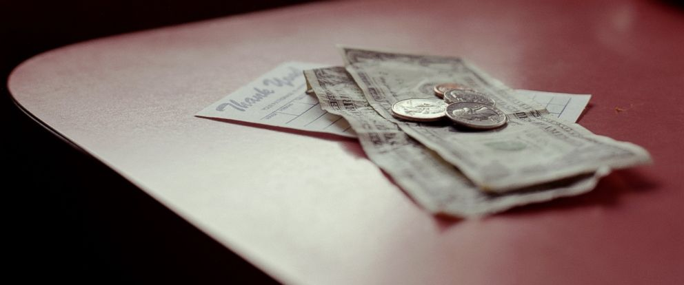 PHOTO: A tip sits on top of a check at a restaurant.