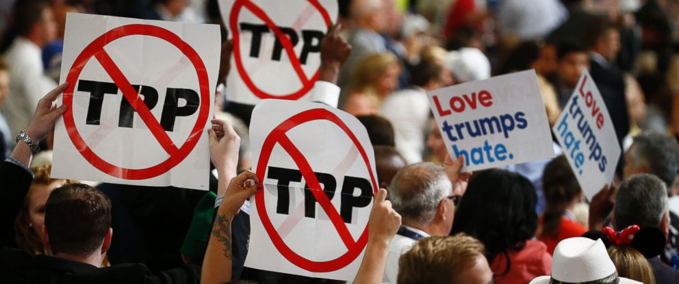 PHOTO: Delegates hold signs against the Trans-Pacific Partnership (TPP) during the Democratic National Convention (DNC) in Philadelphia, July 25, 2016.