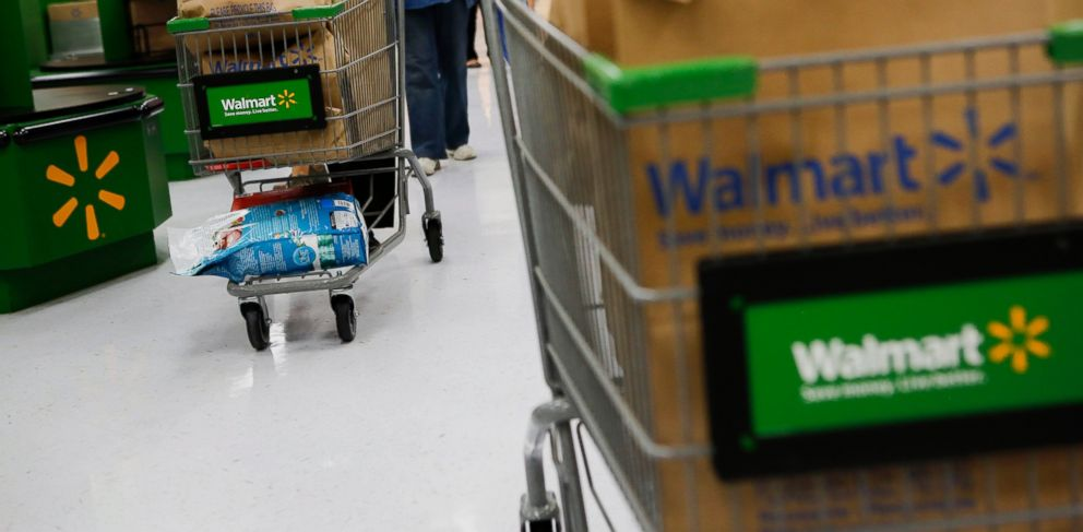 PHOTO: Customers push shopping carts at a Wal-Mart