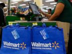 PHOTO: A cashier checks out customers during the grand opening of a Wal-Mart Stores Inc. location in the Chinatown neighborhood of Los Angeles, Sept. 19, 2013.