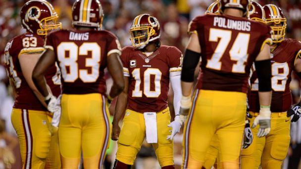 PHOTO: Quarterback Robert Griffin III, #10 of the Washington Redskin,s talks to his team in the huddle in the first quarter against the Philadelphia Eagles, Sept. 9, 2013 in Landover, Md.