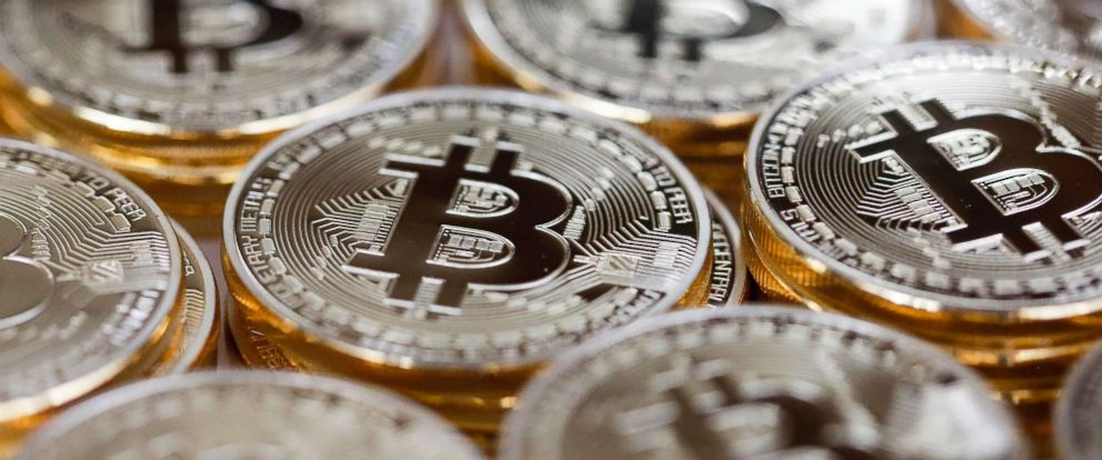 PHOTO: A collection of Bitcoins stand in this arranged photograph in Danbury, U.K., Dec. 10, 2015.