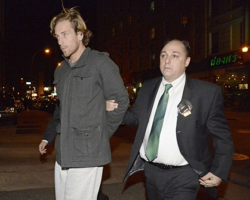 PHOTO:Thomas Gilbert, Jr. is walked into Central Booking at Manhattan Criminal Court, Jan. 5, 2015. Gilbert is charged with murdering his father, hedge fund owner Thomas Gilbert, Sr.