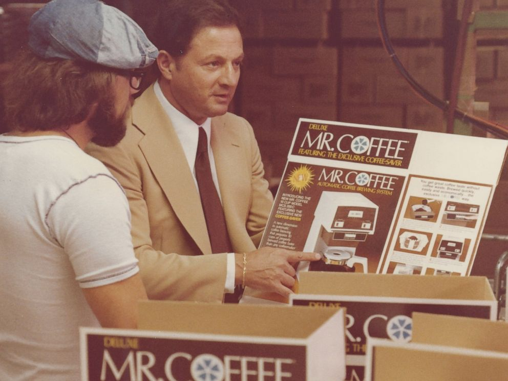PHOTO: In this file photo, Vincent Marotta looks over the product packaging of Mr. Coffee, 1978.