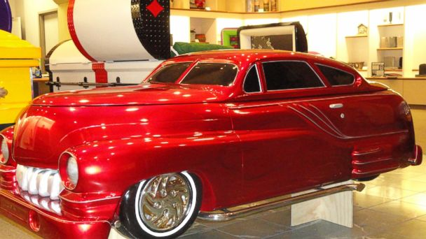 PHOTO: A red casket in shape of a 1950 Mercury automobile.