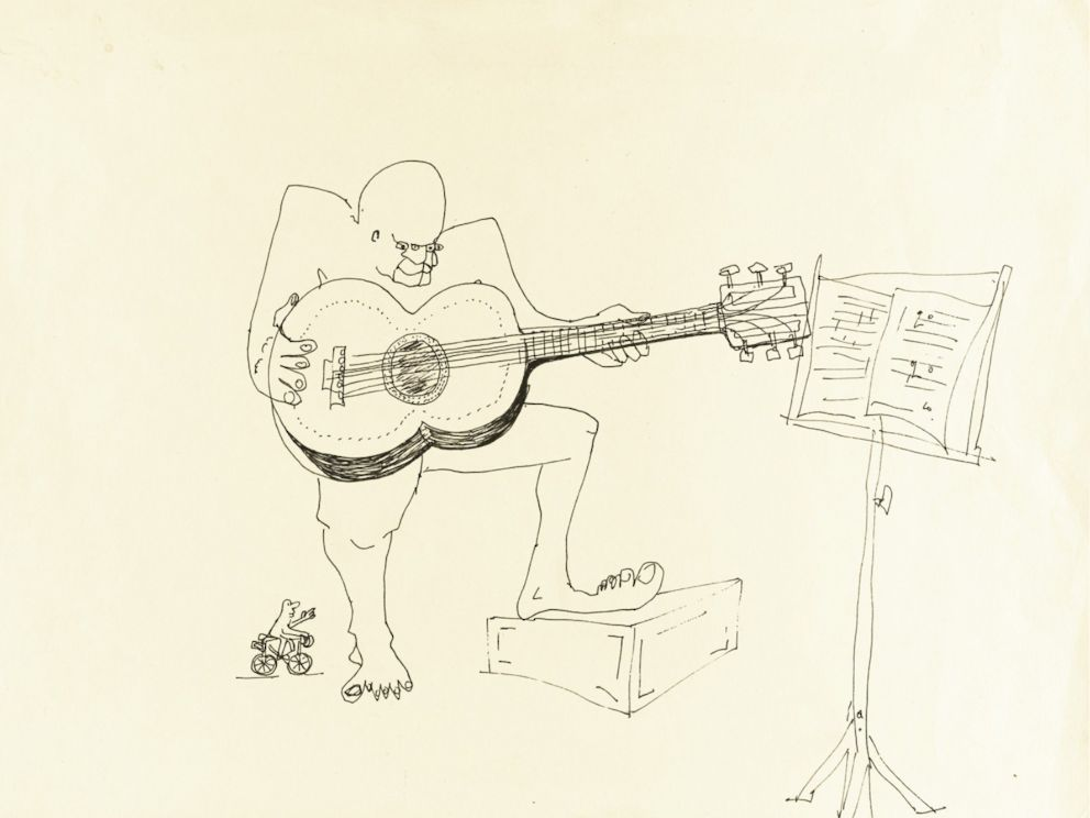 PHOTO: John Lennons untitled ink drawing of a four-eyed guitar player is up for auction. <p itemprop=