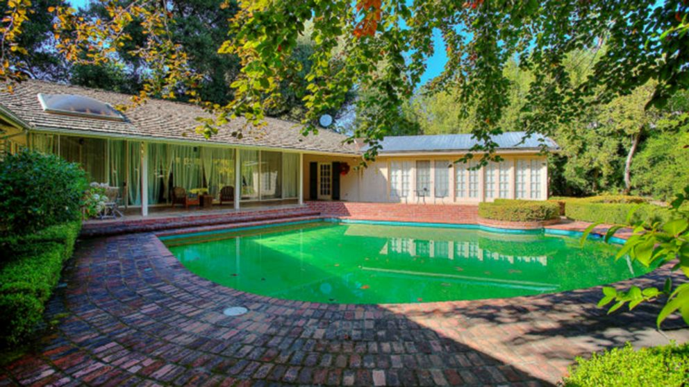 Facebook founder Mark Zuckerberg purchased four of the surrounding houses near his Palo Alto home. Behind his current house, this pictured home sold for $4.8 million in Dec. 2012.