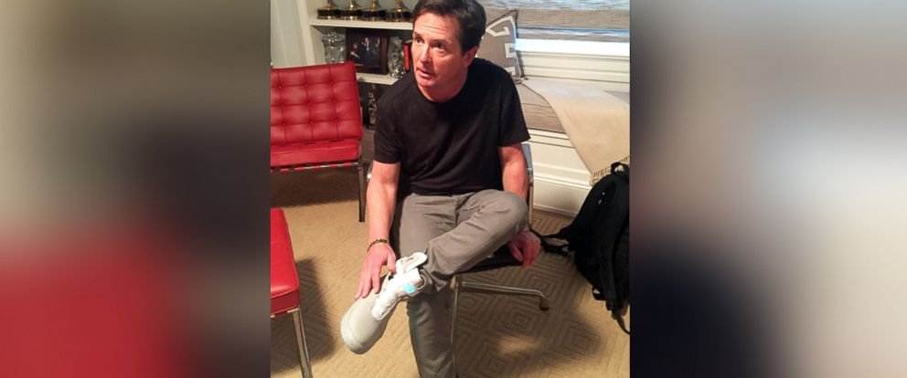 "PHOTO: The MIchael J Fox Foundation shared this image to their Twitter, Oct. 21, 2015, of MIchael J. Fox trying on similar Nike sneakers from the movie ""back to the Future Part II"" set to be released in 2016."