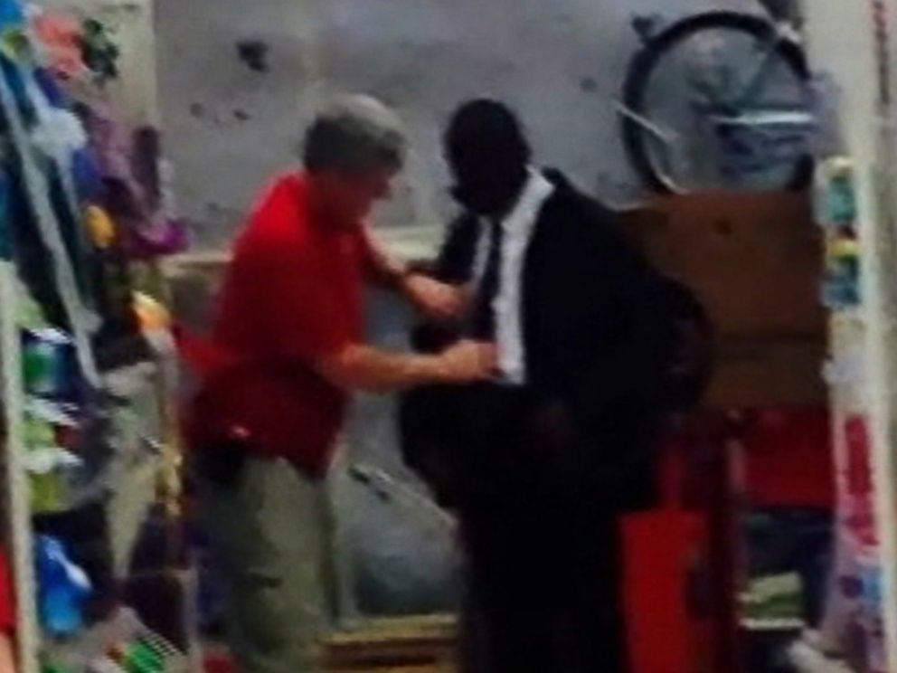 PHOTO: Target workers help a young man prep for job interview.