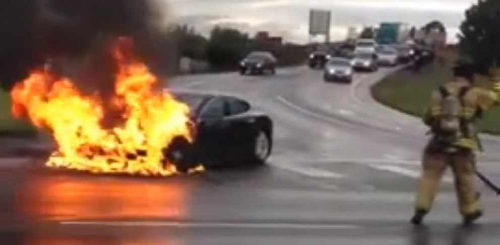 PHOTO: A firefighter arrives to extinguish a burning Tesla Model S on Washington State Route 167 outside of Seattle.
