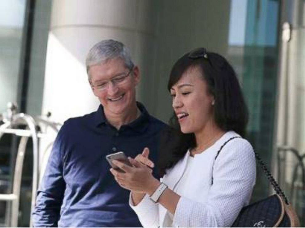 PHOTO: Tim Cook, CEO of Apple, and Jean Liu, president of Didi Chuxing, took a Didi taxi ride to a panel of Chinese app developers hosted by Apple on May 16, 2016, at the Apple Store in Wangfujing, Beijing.