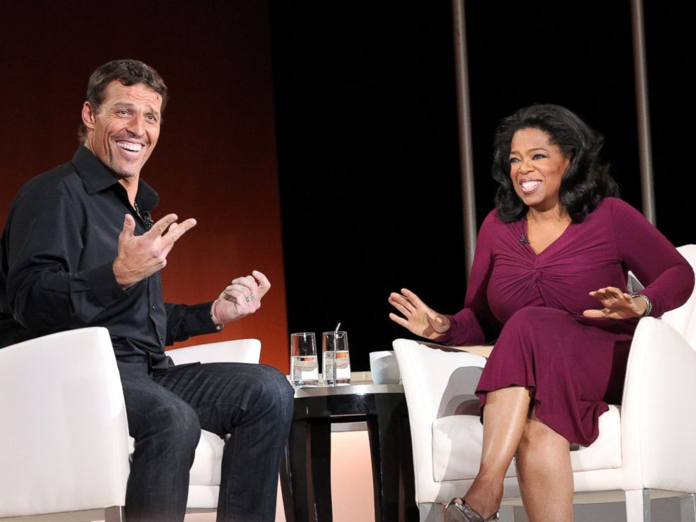 PHOTO: Tony Robbins, a New York Times Bestselling Author, speaks with Oprah Winfrey.