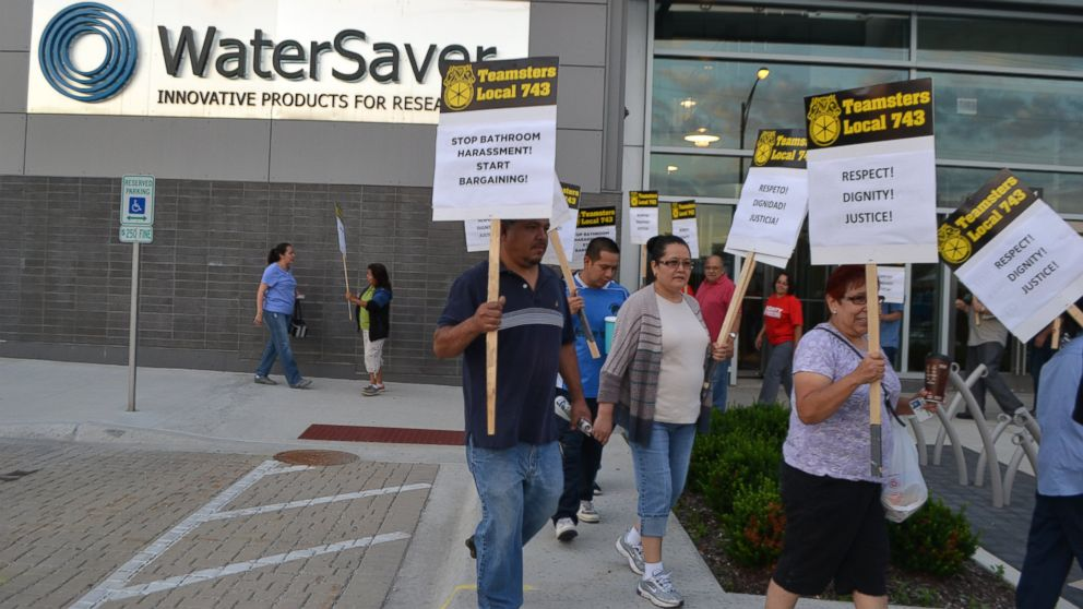 "Members of the Teamsters Local 743 chapter participate in a ""Stop Bathroom Harassment, Start Bargaining"" rally in front faucet maker WaterSaver in Chicago."