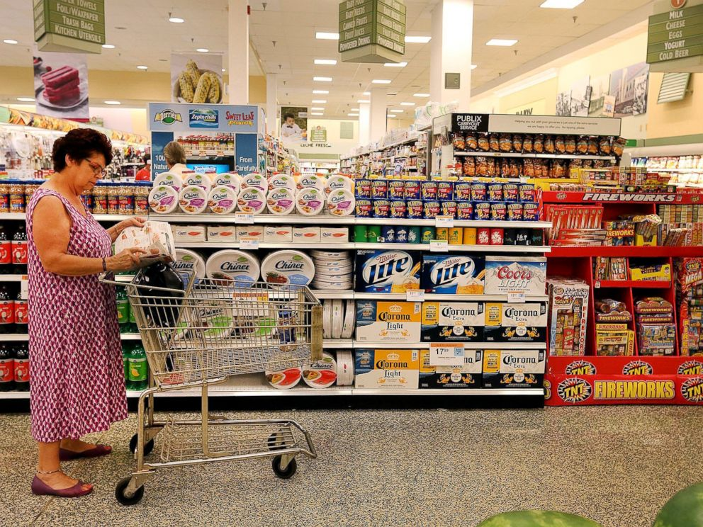 PHOTO: A patron checks for sale items as she pauses near a Publix display in this file photo.