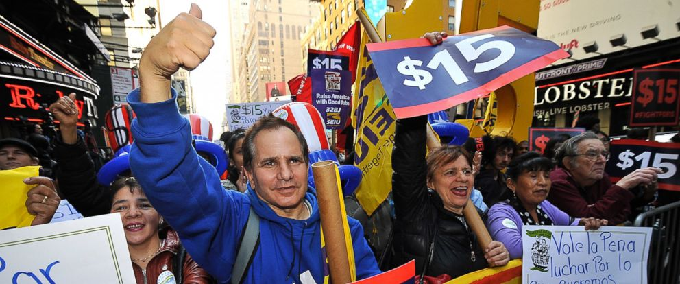 PHOTO: Protesters gather on 7th Avenue, between 42nd and 41st Streets, rallying over the $15 minimum wage increase on April 14, 2016 in New York City.