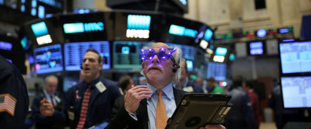 """PHOTO: A trader wears glasses that say """"2017"""" ahead of the new year on the floor of the New York Stock Exchange in Manhattan, New York City, Dec. 30, 2016."""