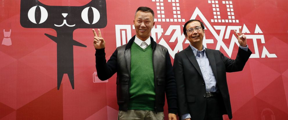 PHOTO: Alibaba Group CEO Jonathan Lu, left, and Alibaba Group COO Daniel Zhang pose for a photo at the companys headquarters in Hangzhou, Zhejiang province Nov. 11, 2014.