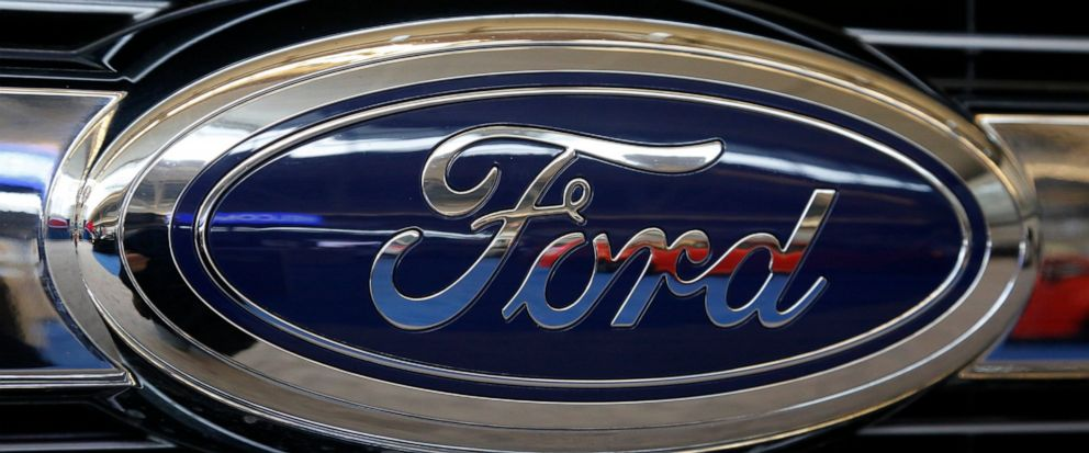 FILE - In this Feb. 11, 2016, file photo the Ford logo on the grill of is displayed at the Pittsburgh International Auto Show in Pittsburgh. Ford is recalling more than 300,000 of its 2017 Ford Explorer vehicles because of a sharp seat frame edge. Th