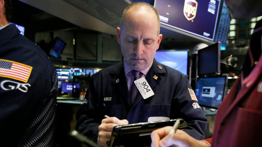 FILE- In this Feb. 5, 2019, file photo trader Michael Urkonis works on the floor of the New York Stock Exchange. The U.S. stock market opens at 9:30 a.m. EST on Thursday, Feb. 28. (AP Photo/Richard Drew, File)