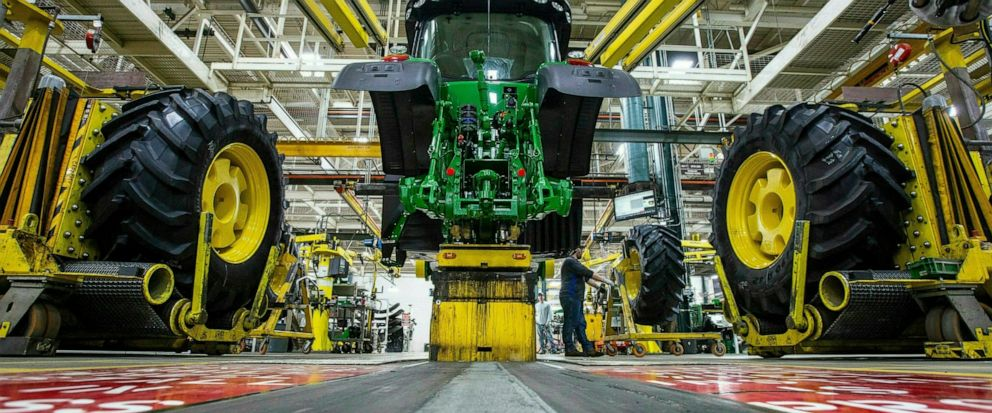 FILE - In this April 9, 2019, wheels are attach as workers assemble a tractor at John Deeres Waterloo, Iowa assembly plant. Deere & Co. reports earnings on Friday, May 17. (Zach Boyden-Holmes/Telegraph Herald via AP, File)