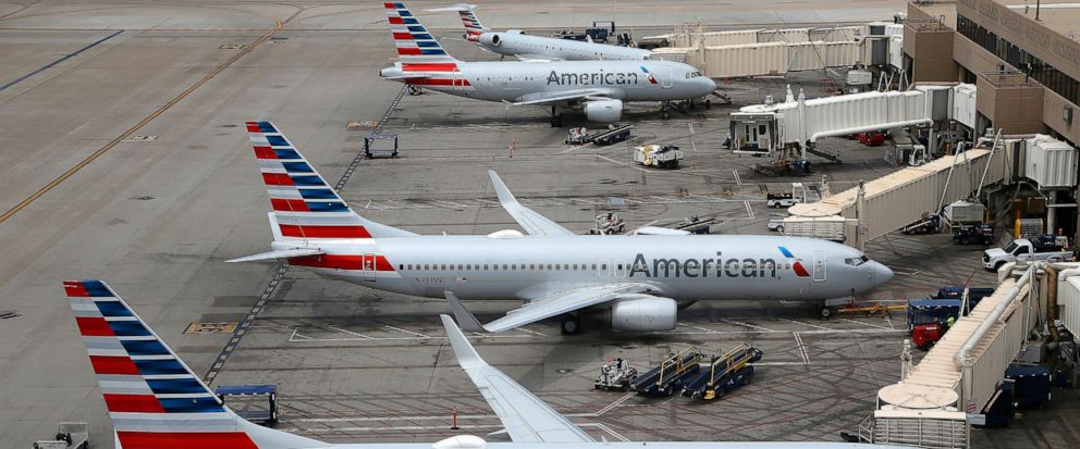 FILE - This July 17, 2019, file photo shows American Airlines planes at Phoenix Sky Harbor International Airport in Phoenix. American Airlines wants two labor unions to pay damages and the company's attorney fees, saying they ignored a judge's order