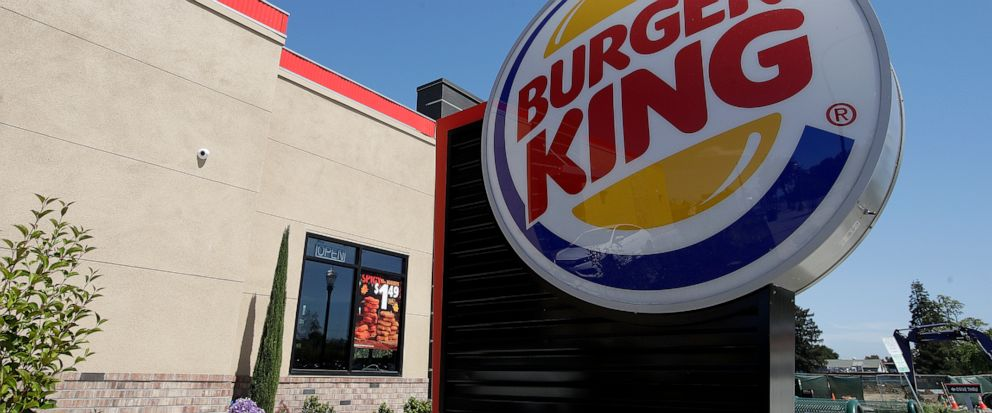 FILE - This April 25, 2019, file photo shows a Burger King in Redwood City, Calif. The company that owns the Burger King, Popeyes and Tim Hortons chains is expanding delivery in the U.S. and will accelerate restaurant openings worldwide in an ambitio