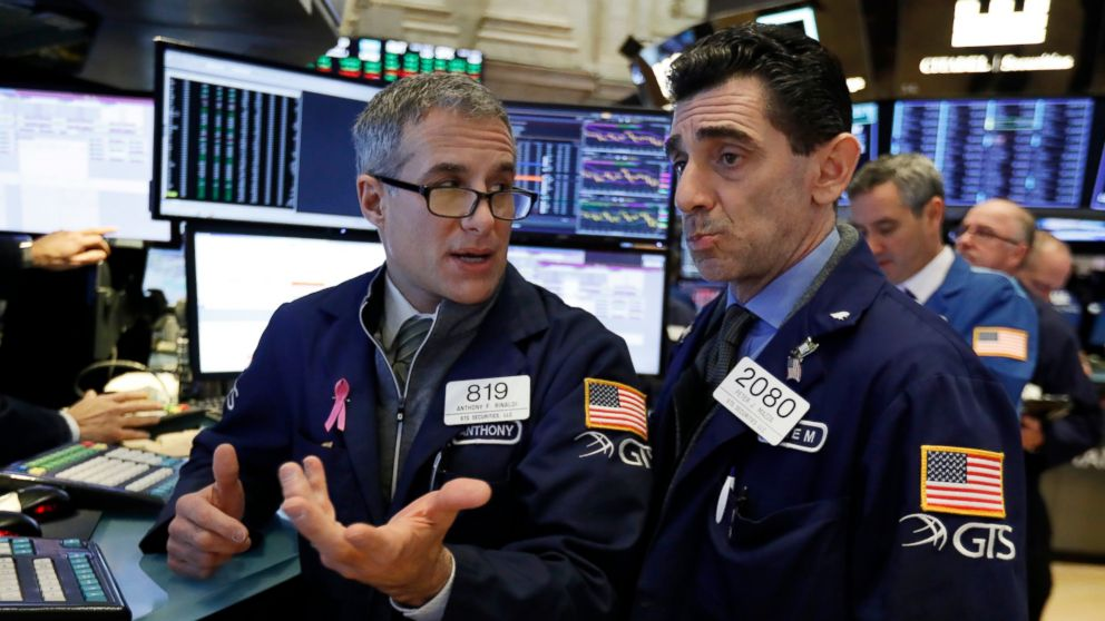 FILE- In this Jan. 4, 2019, file photo specialists Anthony Rinaldi, left, and Peter Mazza confer as they work on the floor of the New York Stock Exchange. The U.S. stock market opens at 9:30 a.m. EST on Friday, Jan. 11. (AP Photo/Richard Drew, FIle)
