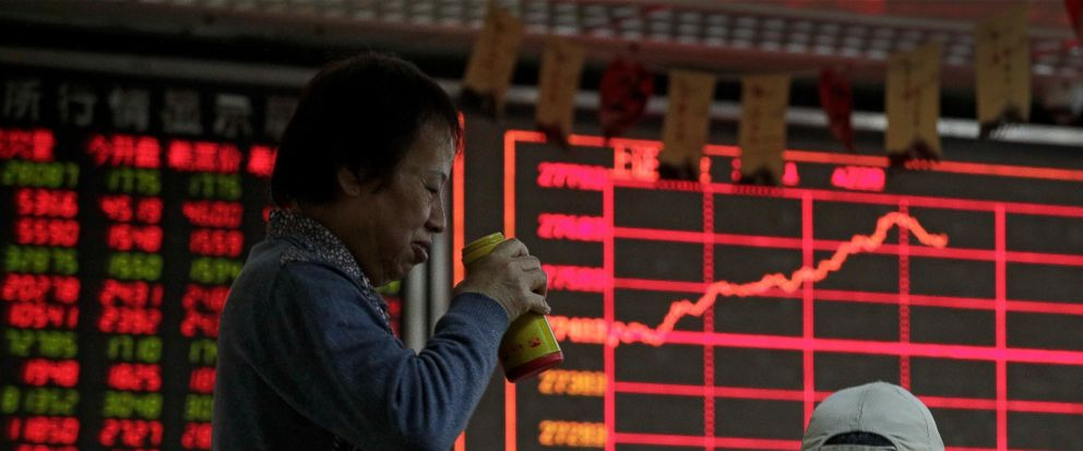 Investors chat as they monitor stock prices at a brokerage house in Beijing, Wednesday, Jan. 9, 2019. Shares extended gains in Asia on hopes for progress in resolving the tariffs battle between the U.S. and China as talks appeared to have been extend