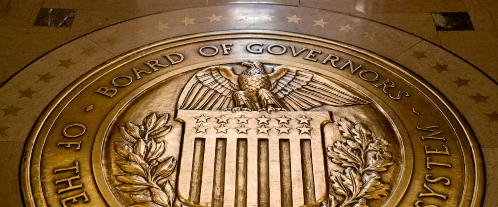 FILE- In this Feb. 5, 2018, file photo, the seal of the Board of Governors of the United States Federal Reserve System is displayed in the ground at the Marriner S. Eccles Federal Reserve Board Building in Washington. On Thursday, Sept. 12, 2019, the