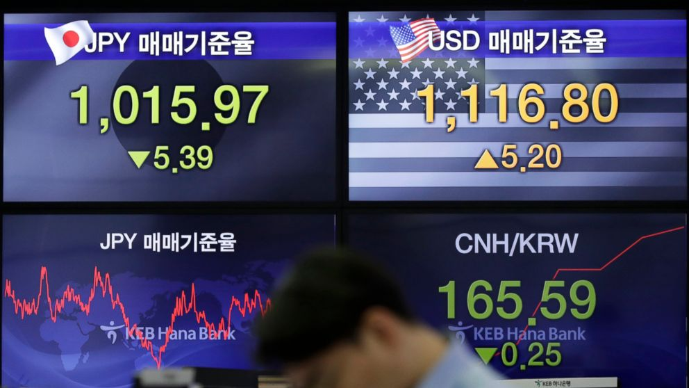 A currency trader works near screens showing the foreign exchange rates at the foreign exchange dealing room in Seoul, South Korea, Thursday, Feb. 7, 2019. Asian shares were mostly higher Thursday on news that the Reserve Bank of Australia may cut interest rates, driving hopes that other central banks could come to the same conclusion. (AP Photo/Lee Jin-man)