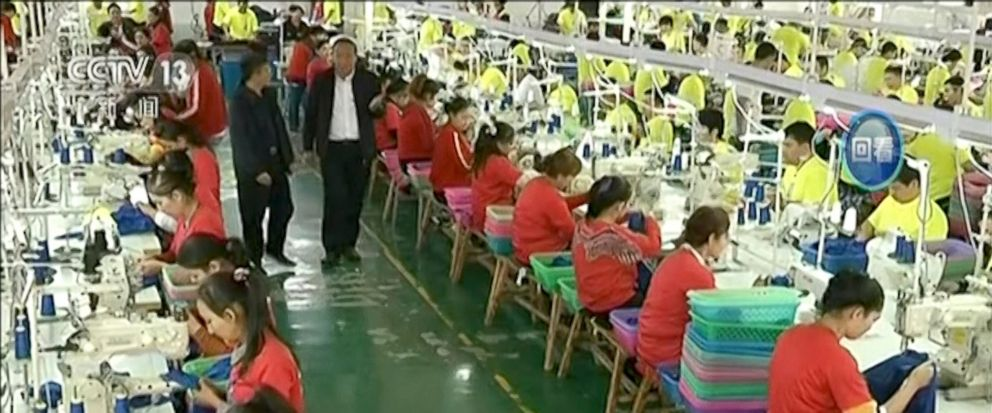 FILE - In this file image from undated video footage run by Chinas CCTV via AP Video, Muslim trainees work in a garment factory at the Hotan Vocational Education and Training Center in Hotan, Xinjiang, northwest China. A U.S. company that stocks col