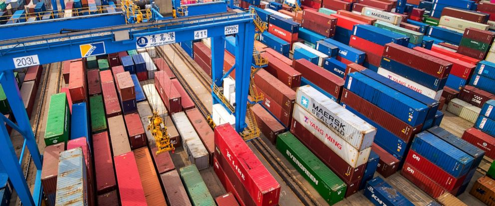 In this Tuesday, May 14, 2019, photo, containers are piled up at a port in Qingdao in east Chinas Shandong province. Chinas imports from the United States plunged 31.4% in June from a year earlier amid a tariff war with Washington, while exports to