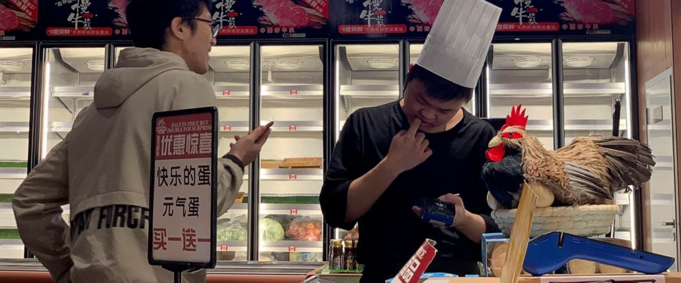 A worker at the imported beef section of a supermarket that used to carry U.S. products chats with another in Beijing on Tuesday, May 14, 2019. China announced higher tariffs Monday on $60 billion worth of American goods in retaliation for President