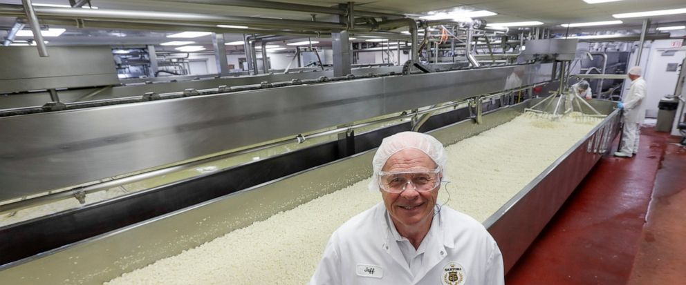 In this June 7, 2019, photo Jeff Schwager , president of Sartori Cheese poses for a picture at their plant in Plymouth, Wis. Schwager's company, Sartori, faced retaliatory tariffs as President Donald Trump reopened a trade battle with Mexico to press