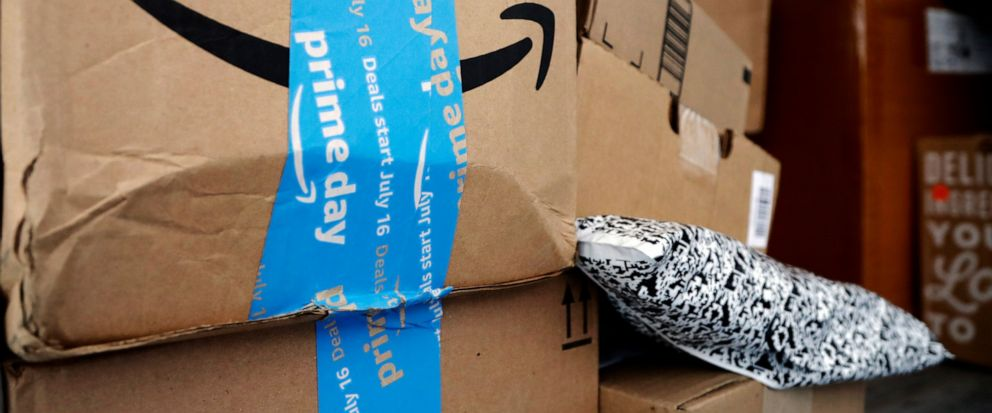 "FILE - In this July 17, 2018, file photo Amazon Prime packages sit in an UPS delivery truck before being unloaded in Miami. Amazon's ""Prime Day"" is back. The made-up holiday, first launched in 2015, has become one of Amazon's busiest shopping days, o"