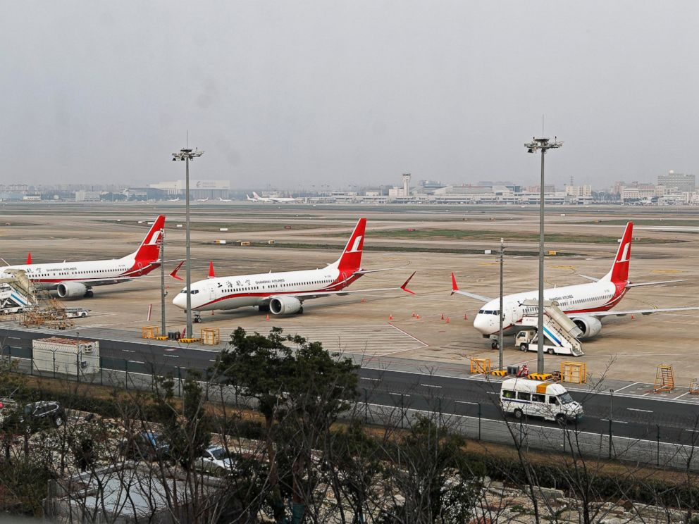 In this photo taken Monday, March 11, 2019, three Shanghai Airlines Boeing 737 Max 8 passenger planes are parked at the Hongqiao Airport in Shanghai, China. U.S. Aviation experts on Tuesday, March 12, 2019 joined the investigation into the crash of a