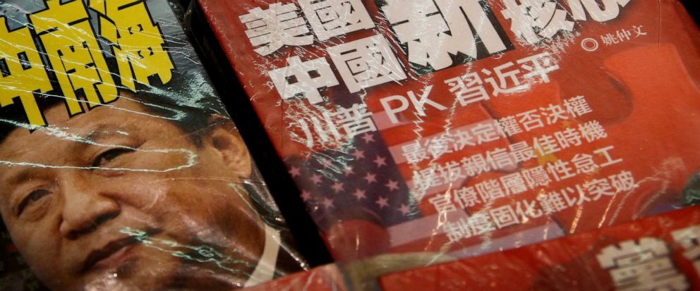 In this Thursday, July 4, 2019, photo, magazines with a front cover featuring Chinese President Xi Jinping against U.S. President Donald Trump, trade war and the South China Sea is placed on sale at a roadside bookstand in Hong Kong. The top U.S. and