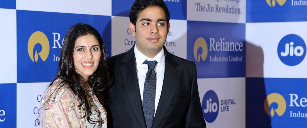Akash Ambani with wife Shloka pose for the media at the 42nd Annual General Meeting (Post-IPO) of Reliance Industries Limited in Mumbai, India, Monday, Aug. 12, 2019. (AP Photo/Rajanish Kakade)
